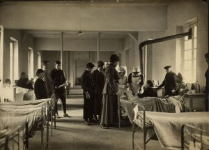 Dr. Louise Hurrell and Dr. Inez Bentley in the men's ward at an American Women's Hospital in Luzancy, France, 1918