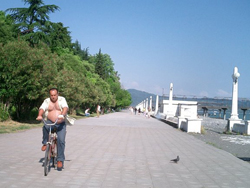 A lone bicyclist rides along the promenade in Sukhumi, Abkhazia.